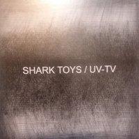 Shark Toys  /  Uv-Tv - Split